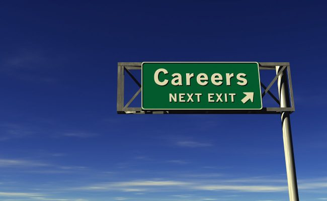 highway sign with careers, next left on it